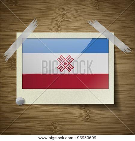 Flags Mari El At Frame On Wooden Texture. Vector