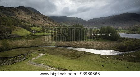 Stormy Dramatic Sky Over Lake District Countryside Landscape