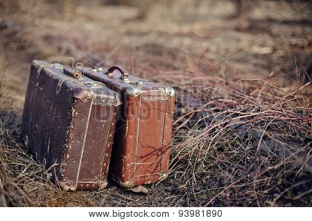 Two Old Shabby Suitcases