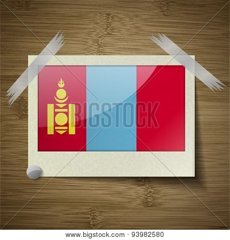 Flags Mongolia At Frame On Wooden Texture. Vector