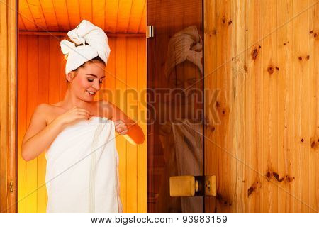 Woman Relaxing In Wooden Sauna Room