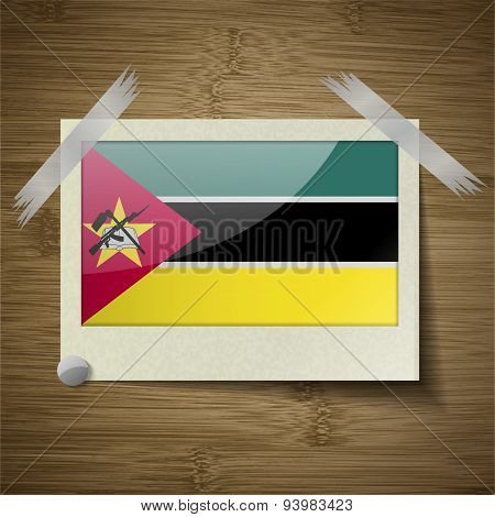 Flags Mozambique At Frame On Wooden Texture. Vector