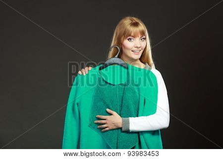Fashionable Woman Holding Green Coat