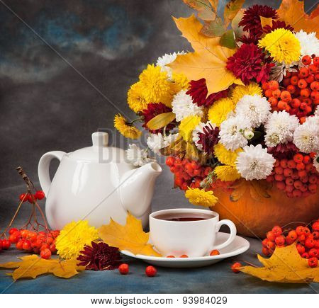Autumn Still Life. Tea, Flower And Yellow Leaves