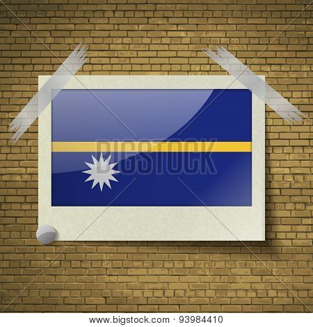 Flags Nauruat Frame On A Brick Background. Vector