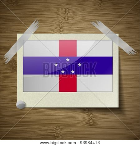 Flags Netherlands Antilles At Frame On Wooden Texture. Vector