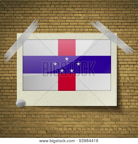 Flags Netherlands Antillesat Frame On A Brick Background. Vector