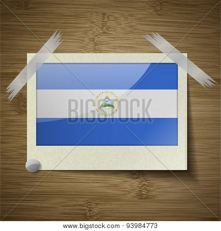 Flags Nicaragua At Frame On Wooden Texture. Vector