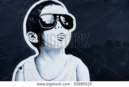 MOSCOW - JUNE 21, 2015: Graffiti on a urban wall (near B. Novodmitrovskaya street). The boy in sunglasses.