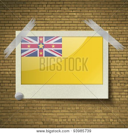 Flags Niueat Frame On A Brick Background. Vector