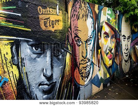 MOSCOW - JUNE 21, 2015: Graffiti on a urban wall (near B. Novodmitrovskaya street). Men's faces.