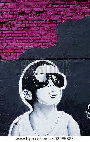 MOSCOW - JUNE 21, 2015: Graffiti on a urban wall (near B. Novodmitrovskaya street). Boy in sunglasses.