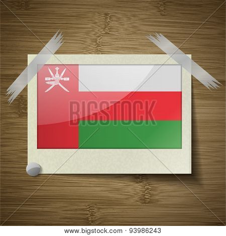 Flags Oman At Frame On Wooden Texture. Vector