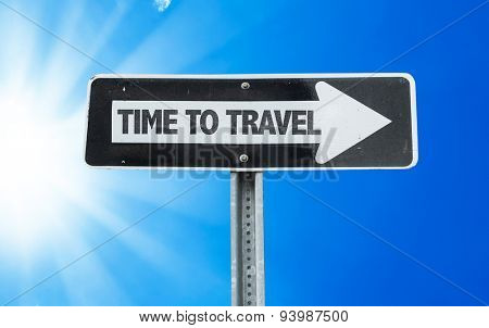 Time To Travel direction sign with a beautiful day