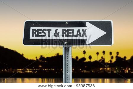 Rest & Relax direction sign with sunset background