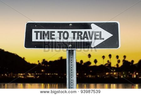 Time To Travel direction sign with sunset background