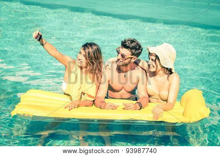 Best Friends Taking Selfie At Swimming Pool With Yellow Airbed - Summer Friendship Concept