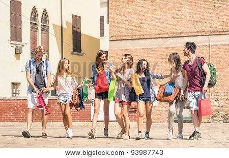 Group Of Happy Best Friends With Shopping Bags In The City Center - Tourists Walking And Having Fun