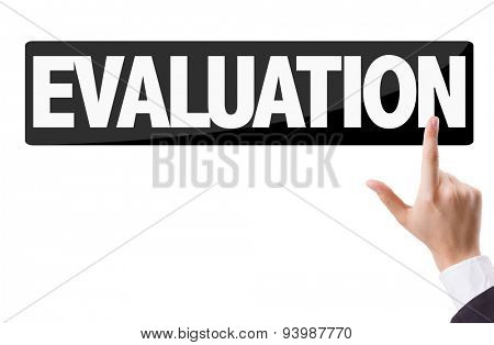 Businessman pressing button with the text: Evaluation