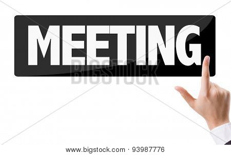 Businessman pressing button with the text: Meeting