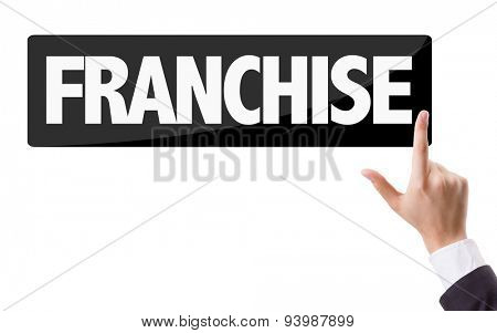Businessman pressing button with the text: Franchise