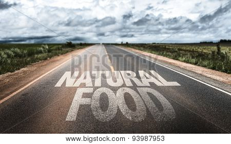 Natural Food written on rural road