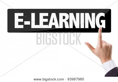 Businessman pressing button with the text: E-Learning