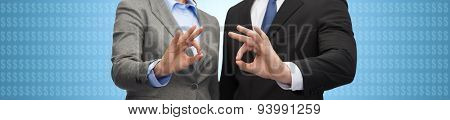 business, people, gesture and cooperation concept - close up of businessman and businesswoman showing ok sign with dollar currency icons over blue background