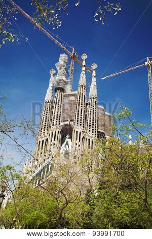 BARCELONA, SPAIN - APRIL 30, 2015: The Basilica of La Sagrada Familia designed by Antoni Gaudi, its construction began in 1882 and is not finished yet.