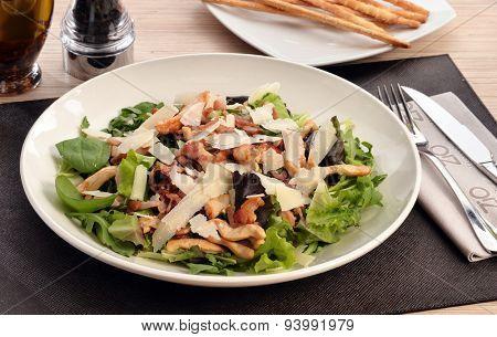 Chicken and parmesan cheese salad dish.