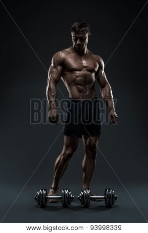 Stunning Muscular Bodybuilder Posing Over Black Background