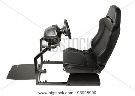 racing simulator cockpit with seat and wheel, isolated on white