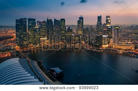 High Angle View Of Singapore City Skyline At Sunset.