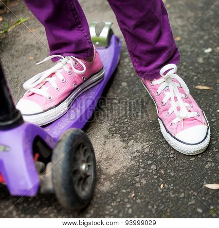 Kid Riding A Scooter. Feet