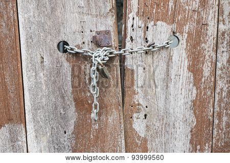 Old Wooden Door With A Locked Door