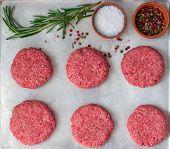 foto of beef-burger  - Raw burgers from organic beef - JPG