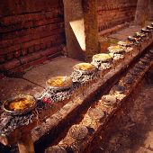 stock photo of buddhist  - Racks for candles in Buddhist temple - JPG