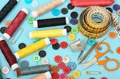 image of sewing  - set of sewing items on blue fabric - JPG