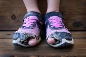 picture of human toe  - Detailed photo of shoes with holes in them and toes sticking out child kid young - JPG