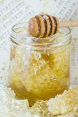 foto of decoupage  - Honeycomb dipper and lemon close up on a handmade decoupage table - JPG