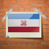 picture of mary  - Flags of Mari El scotch taped to a red brick wall - JPG