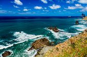 image of atlantic ocean  - Coast or shore of Atlantic ocean with mountain or rock and blue sky with clouds and skyline in Tenerife Canary island Spain at spring or summer - JPG