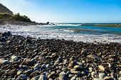 picture of atlantic ocean  - Wild stone beach on coast or shore of the Atlantic ocean with waves and blue sky and horizon in Tenerife Canary island Spain - JPG