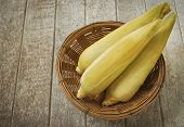 pic of corn  - Corn and sticky corn placed on a wooden table - JPG