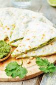 stock photo of cilantro  - Cilantro pesto quesadilla on light wooden background - JPG