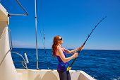 pic of troll  - Beautiful woman girl fishing rod trolling in saltwater in a boat trolling - JPG