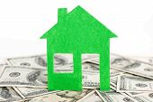 stock photo of model home  - Heap of dollars and green home model - JPG