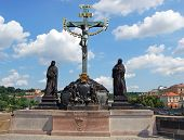 stock photo of crucifix  - Statue of the Holy Crucifix and Calvary along the North side of Charles Bridge  - JPG