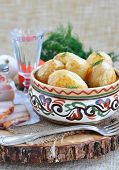 stock photo of baked potato  - baked potatoes in olive oil with fennel or dill - JPG