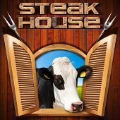 pic of cow head  - Wooden wall with an open window with a head of cow text Steak house and two steel forks - JPG